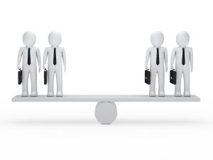 2 white 3D figures standing on each side of perfectly-balanced see-saw